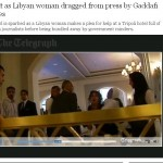 Libyan woman being drug away