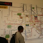 "Drummond Pike and ACORN Kenya organizers looking at the ""matatu"" bus map on the iHub wall"