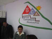 talking with members of Banco Comunitario Alucouho