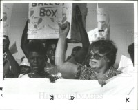 ACORN President Elena Hanggi leads marchers.Rep National Convene Dallas, Republicans in 1984.