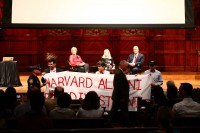 May 2014 A group of prominent Harvard alumni were led out of a reunion ceremony by police on Friday when they unveiled a large banner calling on President Drew Faust to consider reinvesting the school's stakes in fossil fuel companies that they say contribute to climate change and other environmental impacts. Photo Credit:  Divest Harvard