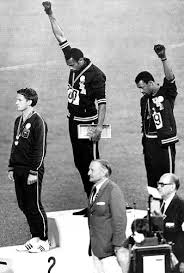 Tommie Smith and John Carlos during the National Anthem. An iconic, wondrous moment of protest during the 1968 Olympics in Mexico when the superstars won the gold and bronze medal in the 200-metre race.