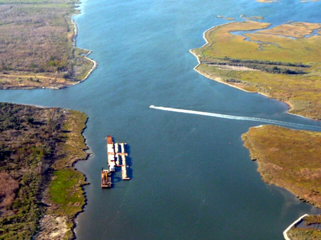 Barges filled with rock are anchored in the Mississippi River Gulf Outlet near Bayou La Loutre on Jan. 30, 2009, ready to start blocking the waterway off from the Gulf of Mexico. The work has since been completed, shutting down the channel.