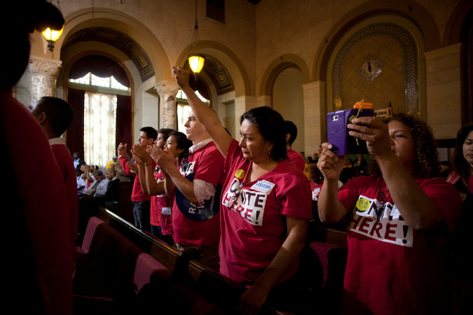 Members of Unite Here Local 11 in the Los Angeles City Council chambers on Tuesday before the Council voted to increase the city's minimum wage from $9. Credit Jenna Schoenefeld for The New York Times