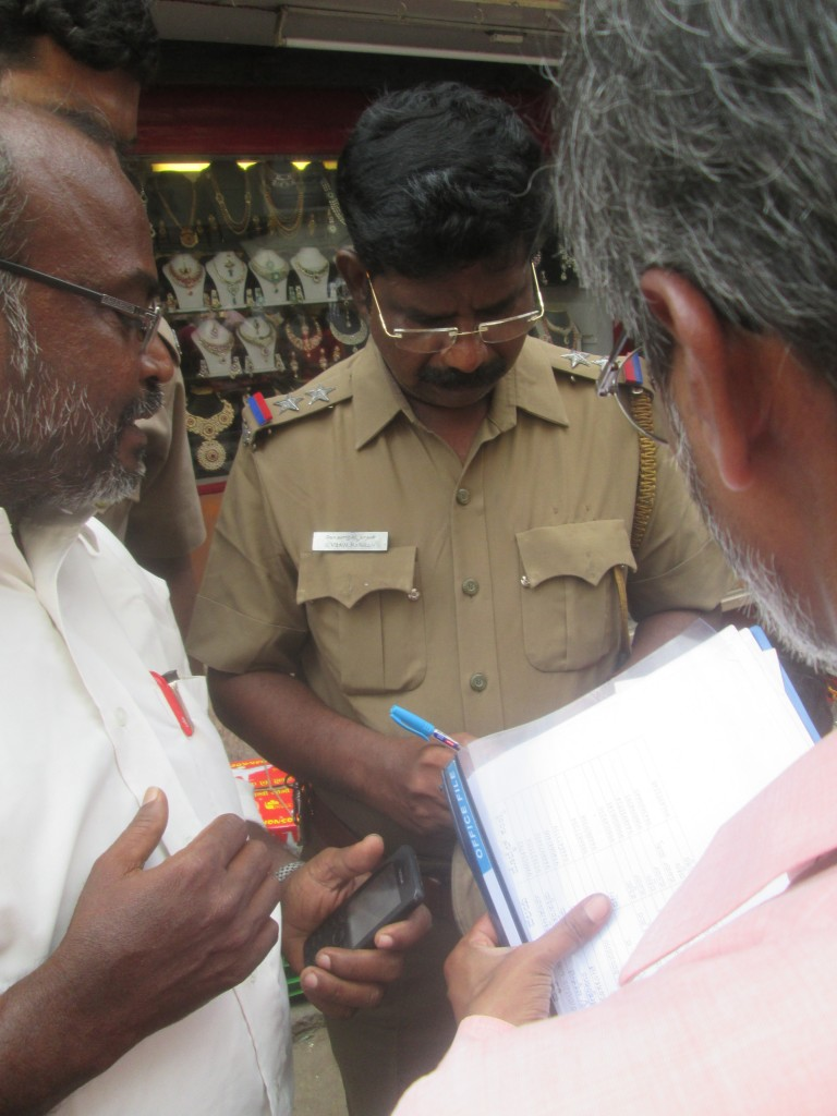 talking to a police harassing us that is in Chennai in the Mint Road market