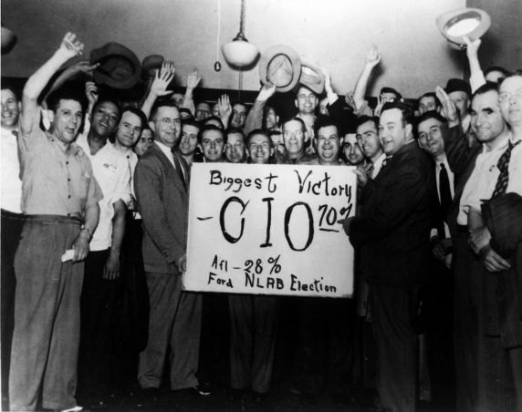 Auto worker celebrate the victory of the UAW-CIO in the Ford National Labor Relations Board (NLRB) election. 1941