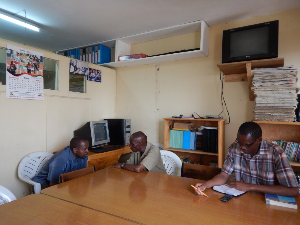ACORN organizers, Sammy and David, prepare for COPA Kenya meeting with chair of ACORN Kenya