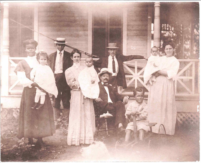 John Abraham Davis, center, and his family at their farm in the early 1900s.