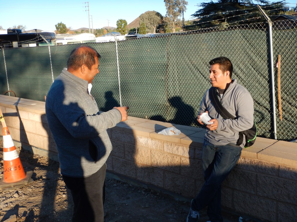 Pablo telling a young worker about the history of the site while he waits for work