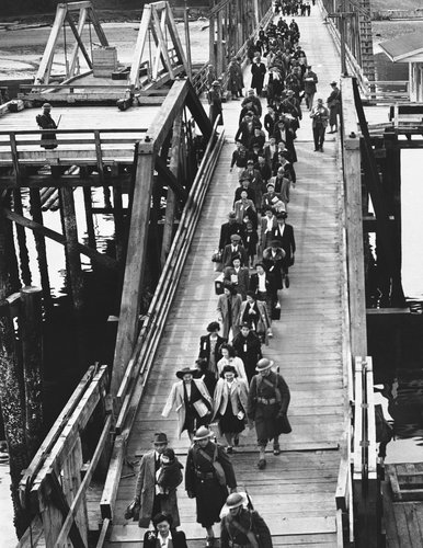 Japanese-American residents of Bainbridge Island, Washington, boarded a ferry to Seattle. From there, they were transferred to a camp in California. Photocredit: Ryan Williams for The New York Times
