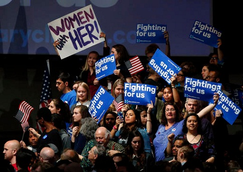 Supporters of Democratic presidential candidate Hillary Clinton cheer at her New York primary campaign headquarters, Tuesday, April 19, 2016, in New York