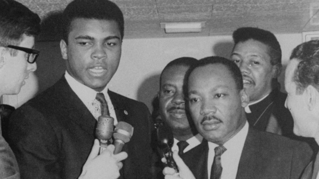 Ali with Dr. King in Louisville at a demonstration on fair housing in 1967