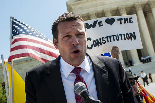 April 25, 2012 - Washington, District of Columbia, U.S. - Kansas Secretary of State KRIS W. KOBACH speaks to the media outside of the Supreme Court on Wednesday after the Court heard arguments on Arizona's controversial immigration law. Kobach played a significant role in the drafting of the law known as Arizona Senate Bill 1070 which seeks to crack down on illegal immigration. (Credit Image: © Pete Marovich/ZUMAPRESS.com)