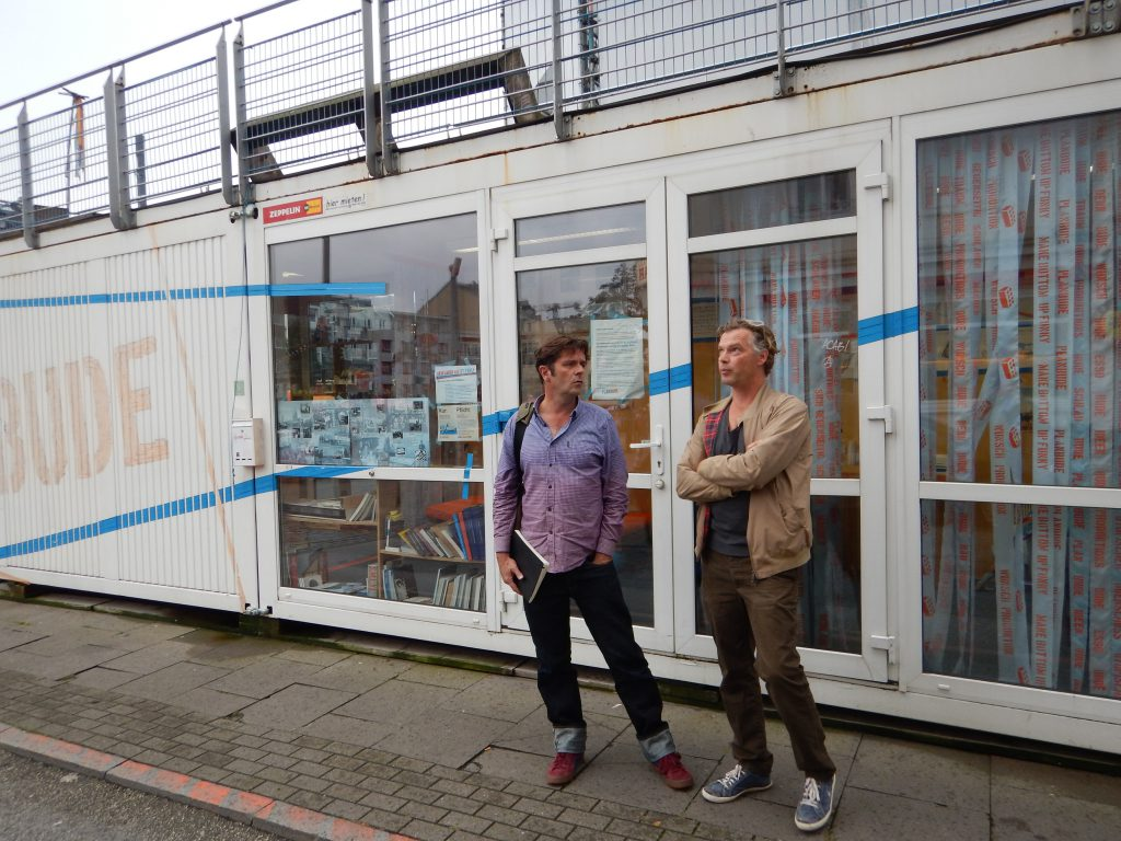 Christoph Schaeffer and Christoph Twickel talking about the community benefit campaign - Plan Buda -- at the Esso Hausen