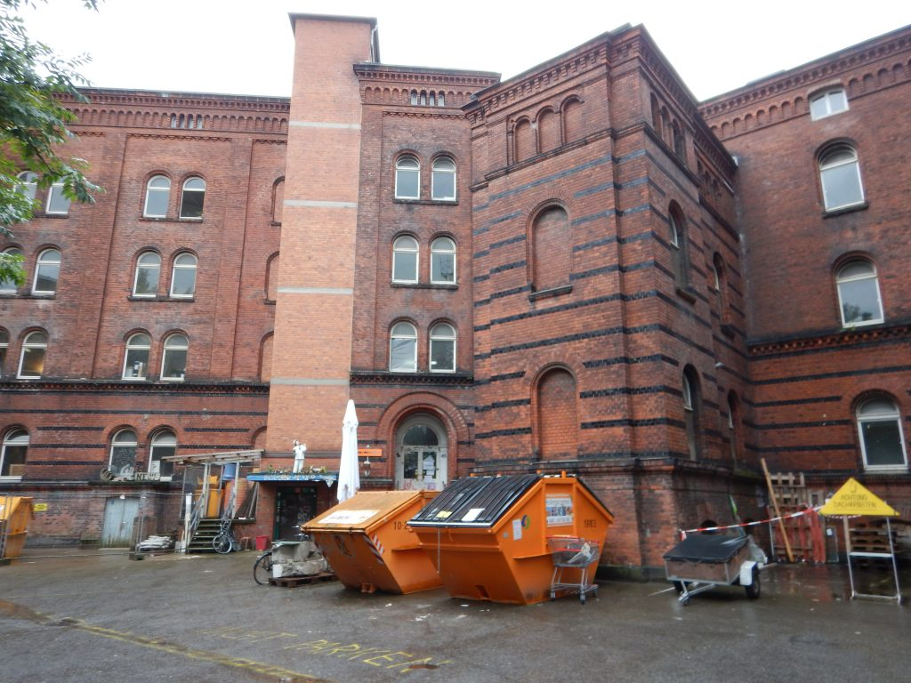 Armory building being converted to community space by the cooperative