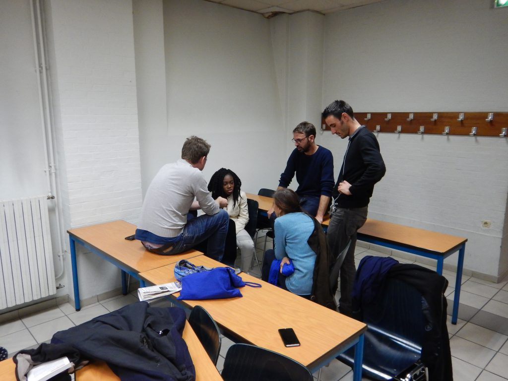 adrien roux of ACORN partner ReAct listens in on a small group at the end of workshop